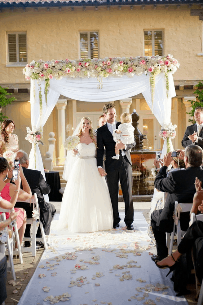 floral & draped wedding archway