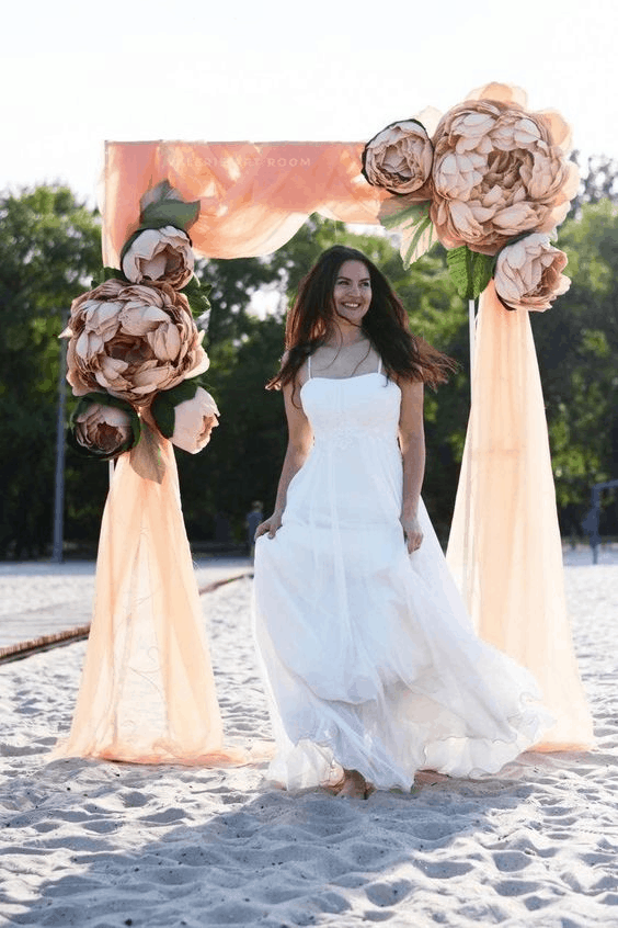 draped arch with fake flowers