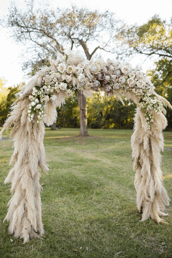 feathery & floral wedding arch idea