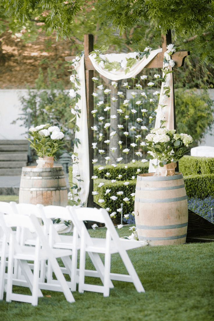 rustic white wedding arbor with flower strings