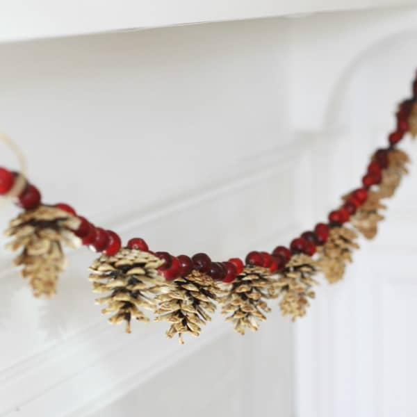 pine cone & cranberry garland christmas wall decor idea