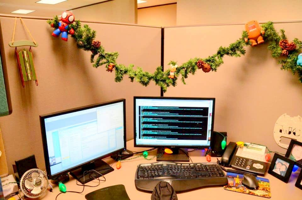 christmas cubicle decoration idea with garland and dolls