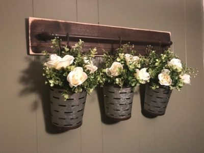rustic wall decor idea olive buckets and flowers