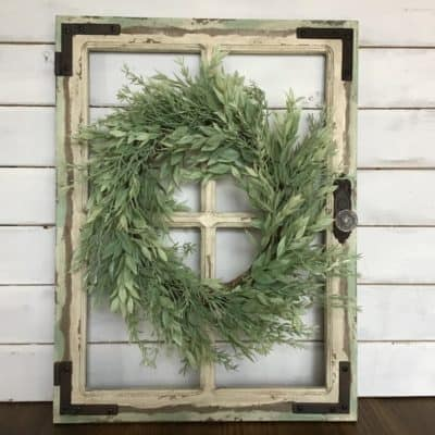 rustic wall decor idea window frame with green wreath