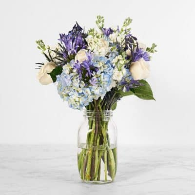 fourth wedding anniversary flower gift: a bouquet of hydrangeas and white roses