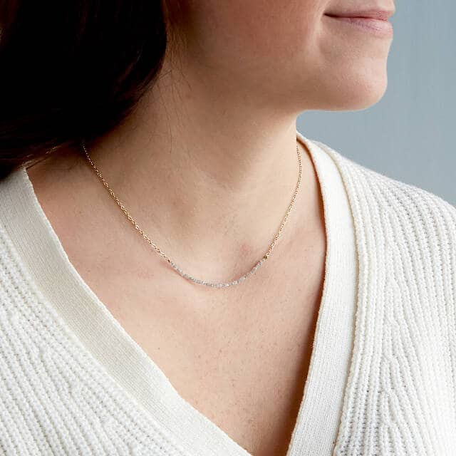 a piece of gold necklace with rough diamonds - 50th wedding anniversary gift idea for her