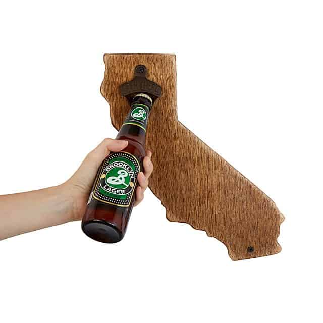 mounted wood bottle opener that has the shape of a state