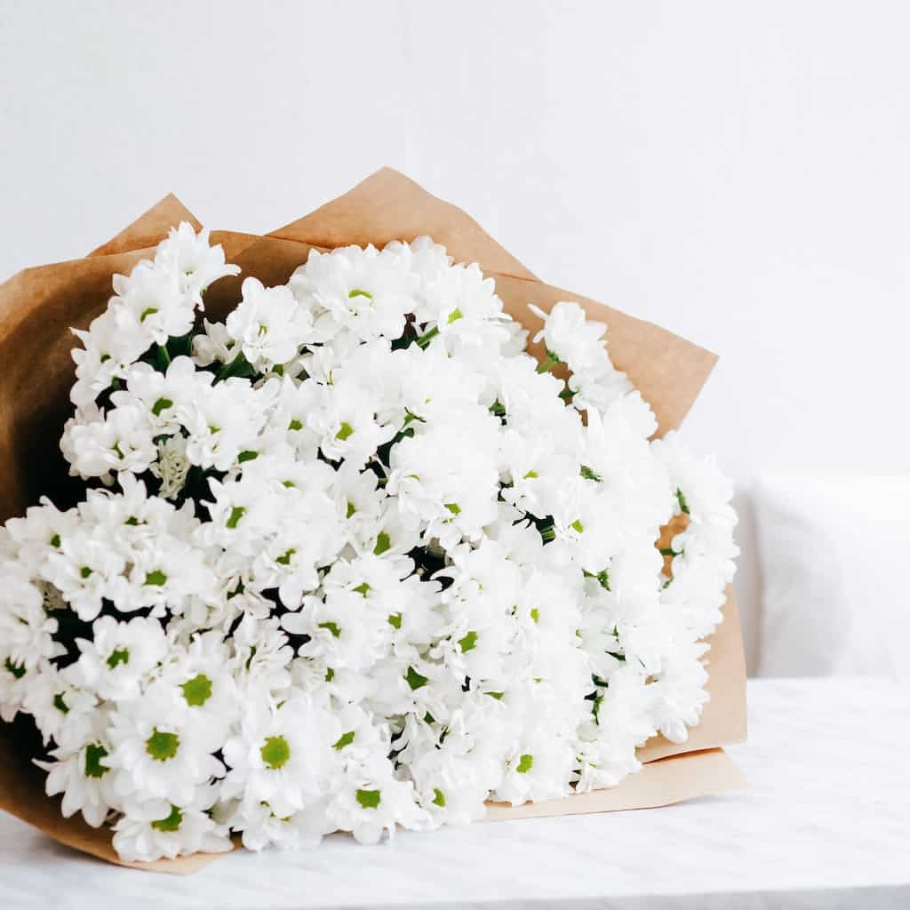 a bouquet of white flowers for 3rd anniversary