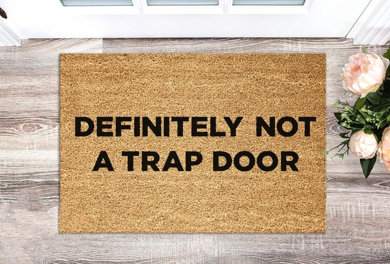 funny doormat: definitely not a trap door - funny christmas & housewarming gift