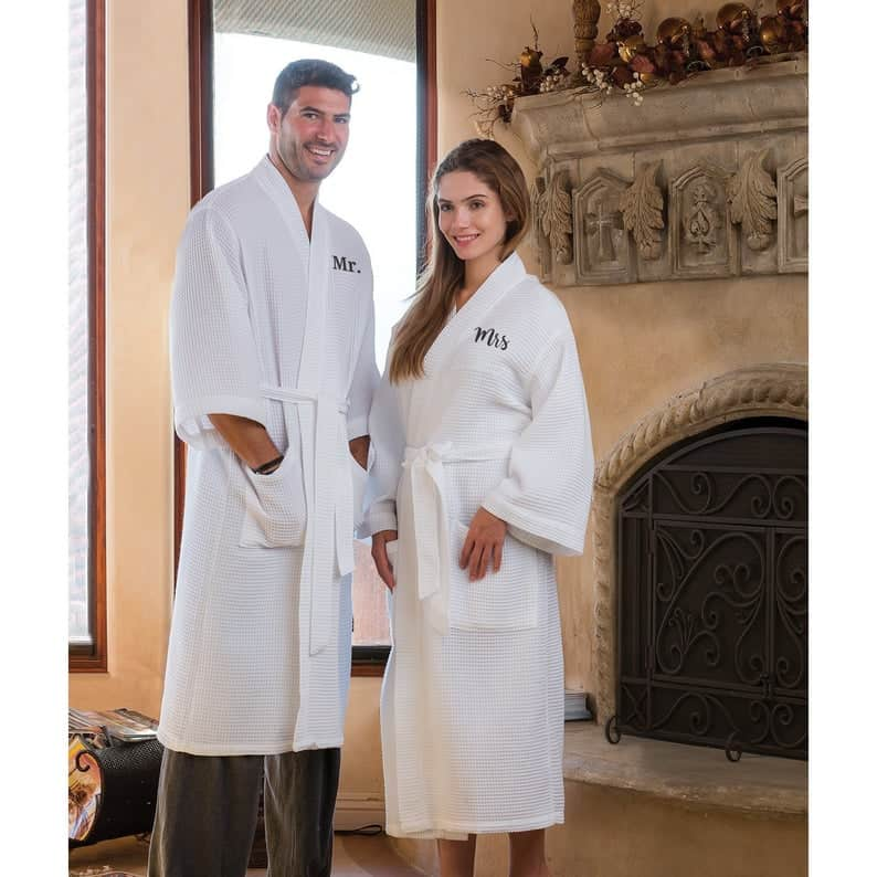 a man and a woman wearing white couple robes