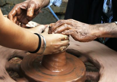 people making pottery
