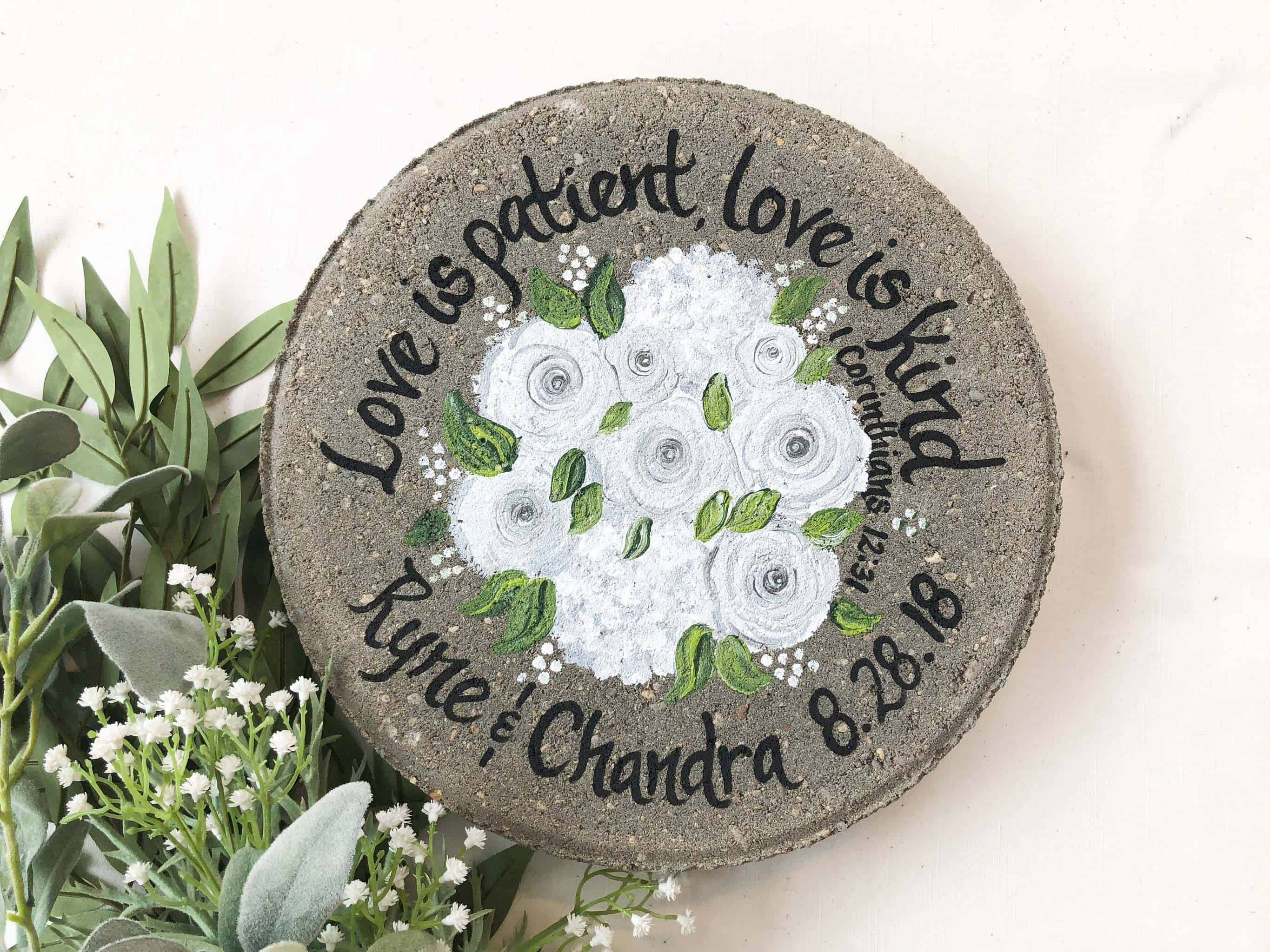 a stone with the quote Love Is Patient, Love Is Kind