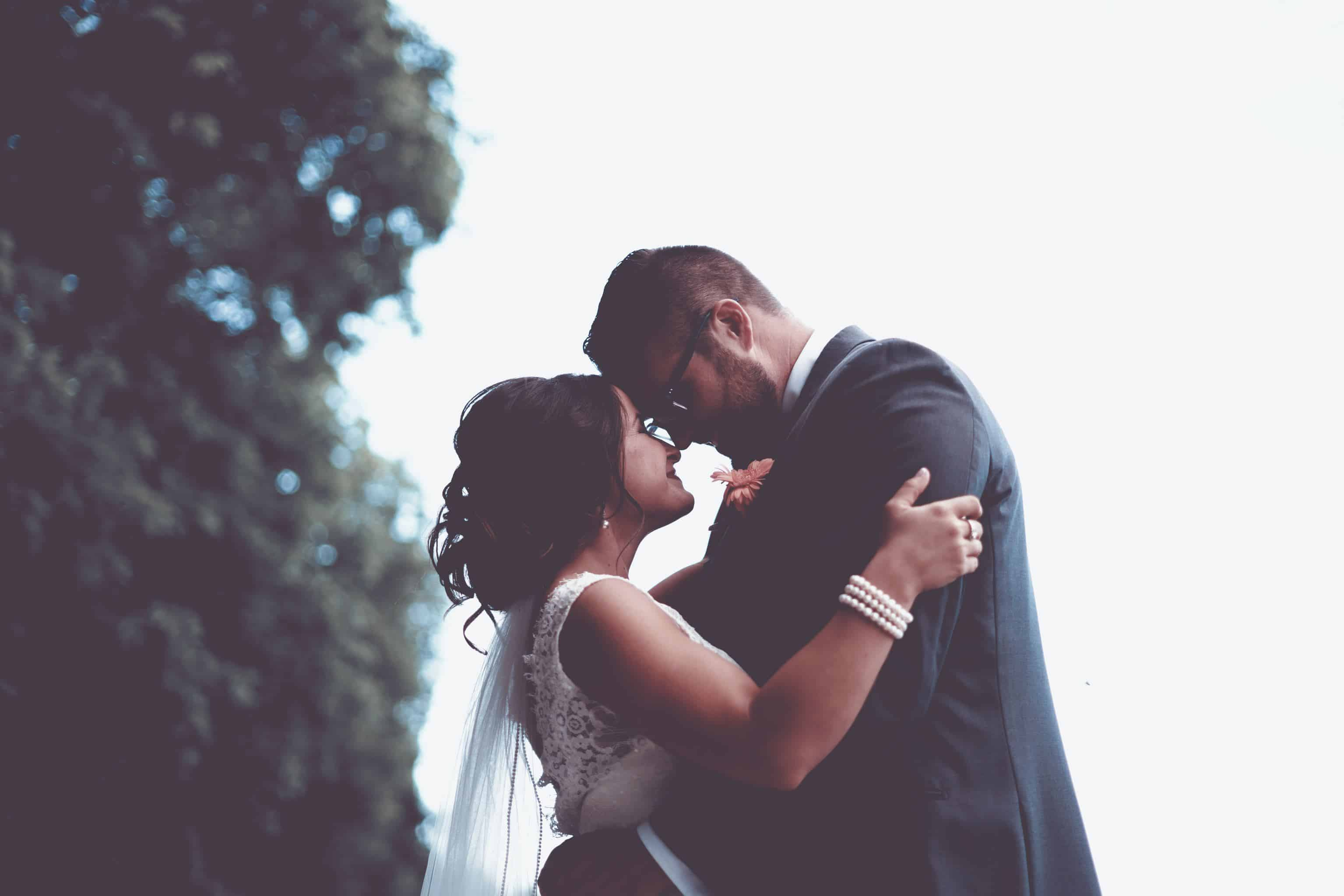 wedding video songs guide: bride and groom holding each other