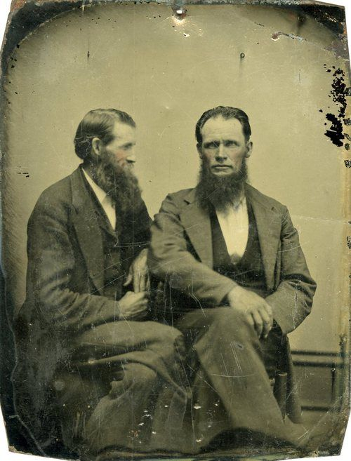 a retro photo of 2 men sitting next to each other