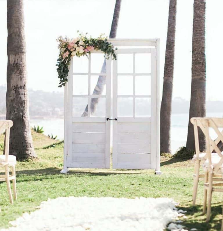 white door wedding arch