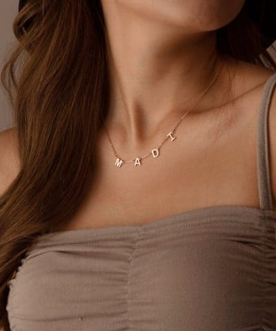 first mothers day jewelry gifts: personalised name necklace