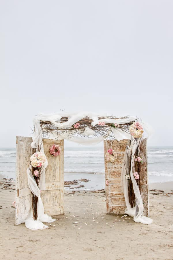 door wedding arbor with twigs, cloths & flowers