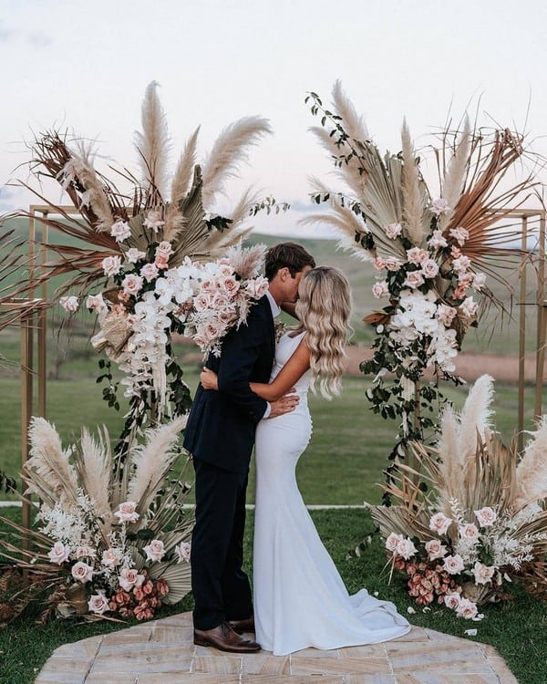 wedding altar decorated with dried flowers and foliage