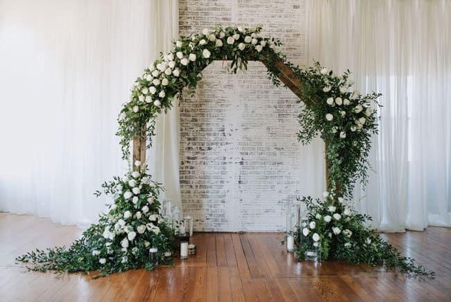 lush hexagonal ceremony arbor