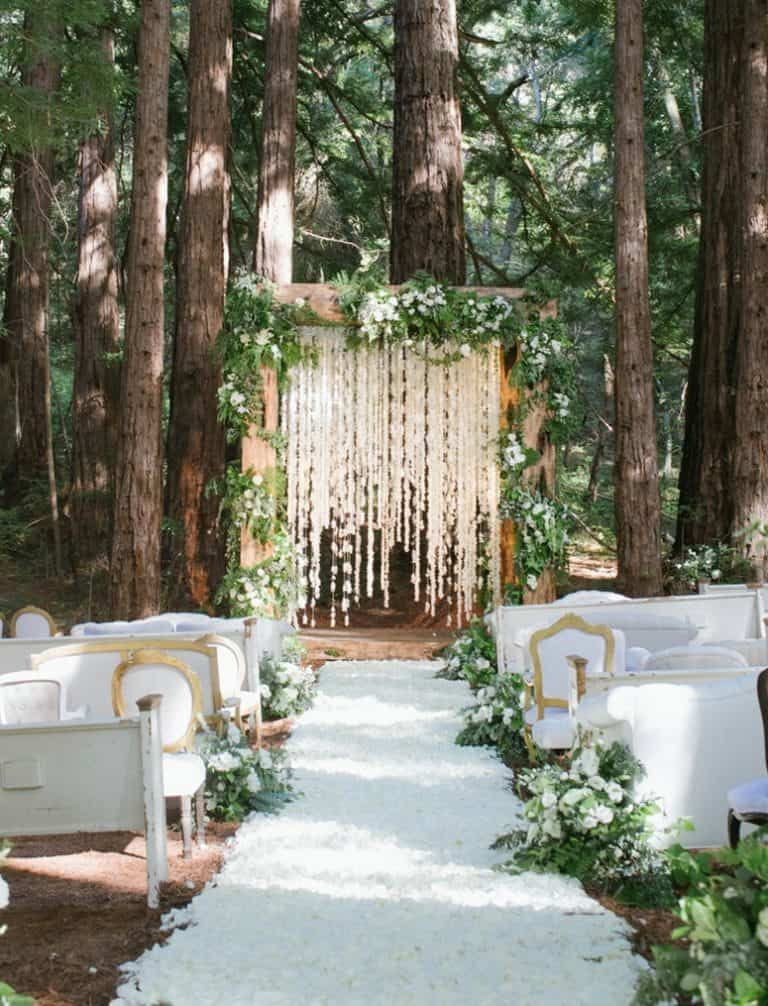 floral wooden arbor in the woods