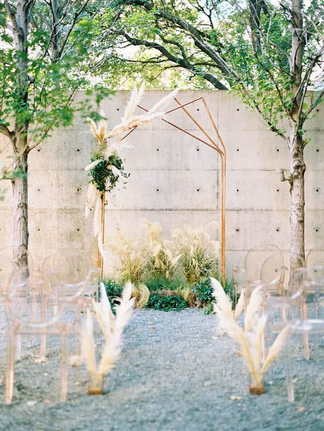minimalistic boho ceremony arbor