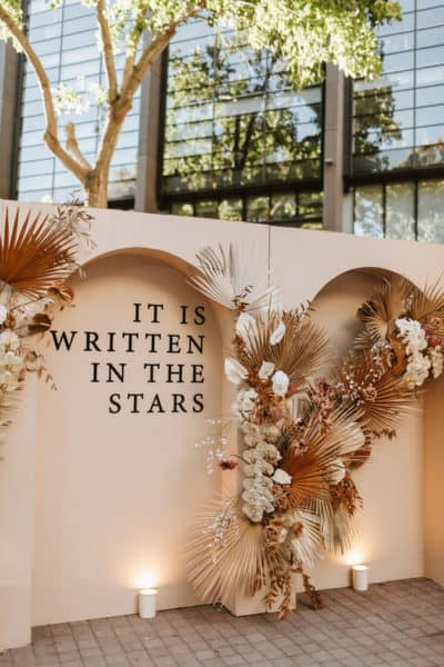 romantic wedding backdrop with quote: it is written in the stars