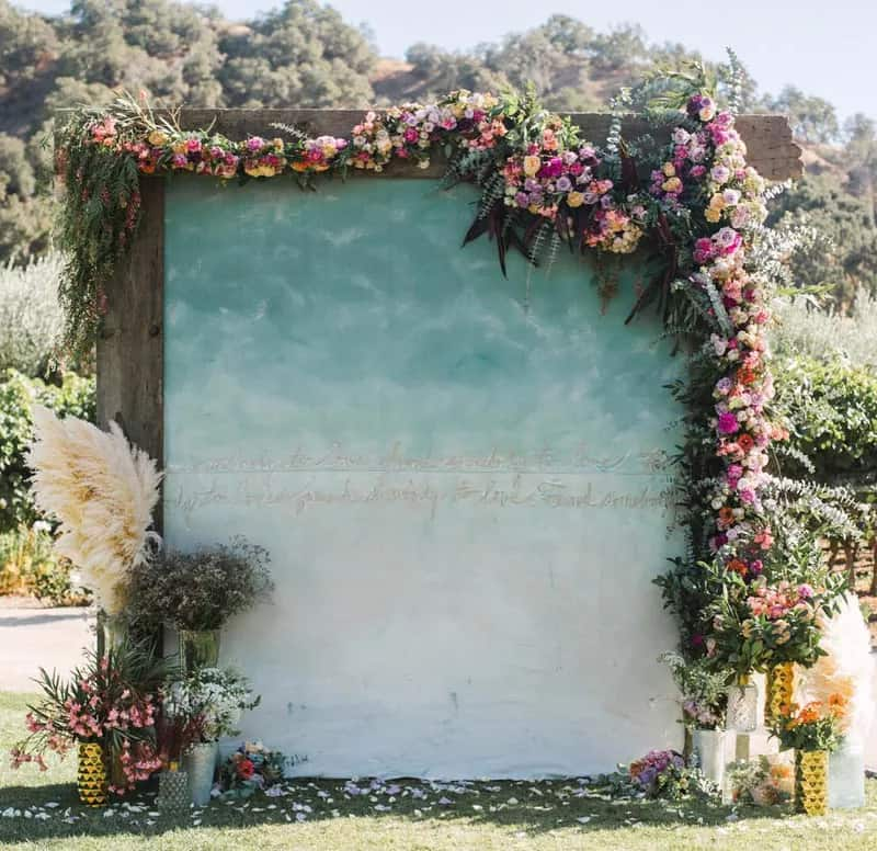 diy photo backdrop with flowers and wooden frame