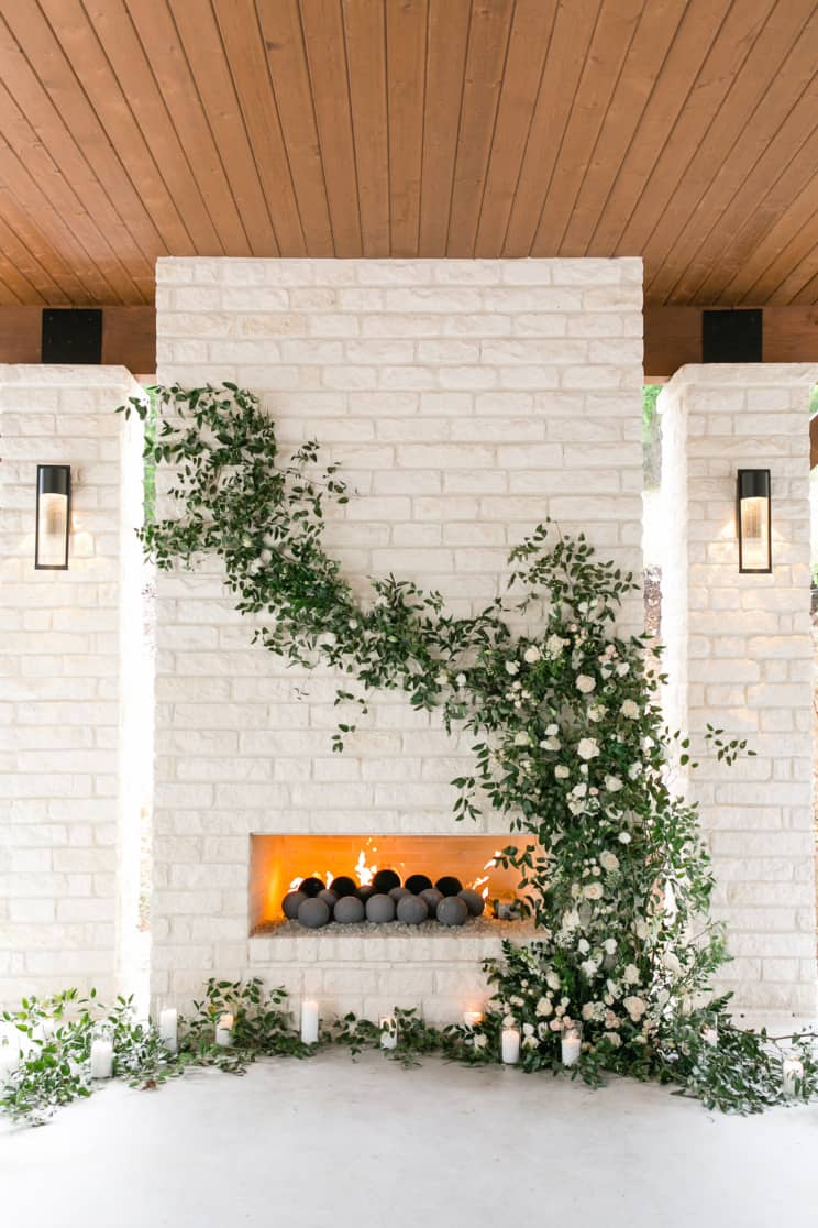 fireplace decorated as a wedding backdrop