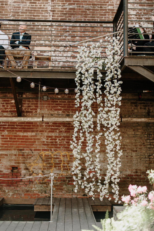hanging flower wedding ceremony backdrop