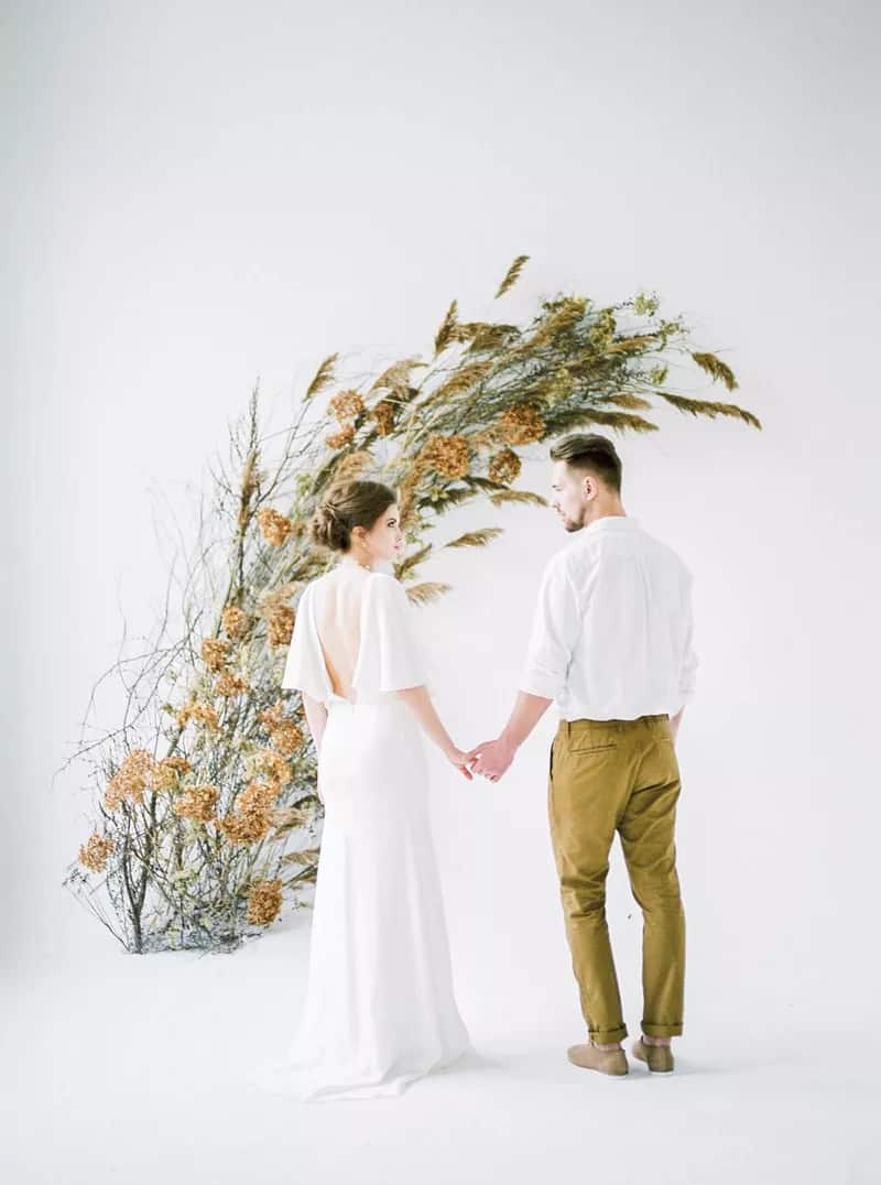 elegant minimalist wedding background with dried twigs and leaves