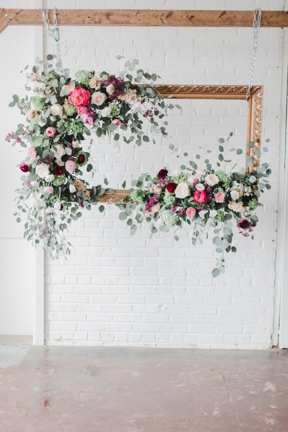 floral picture frame wedding backdrop idea