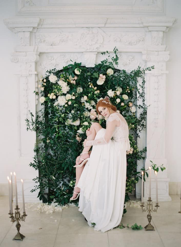 wedding backdrop decorated with greenery