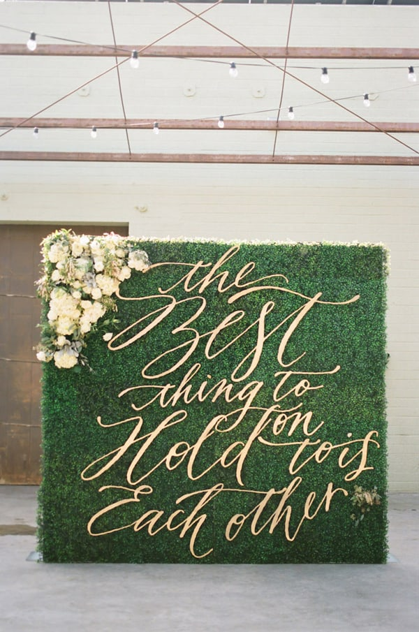 greenery wedding background with quote: the best thing to hold on is each other