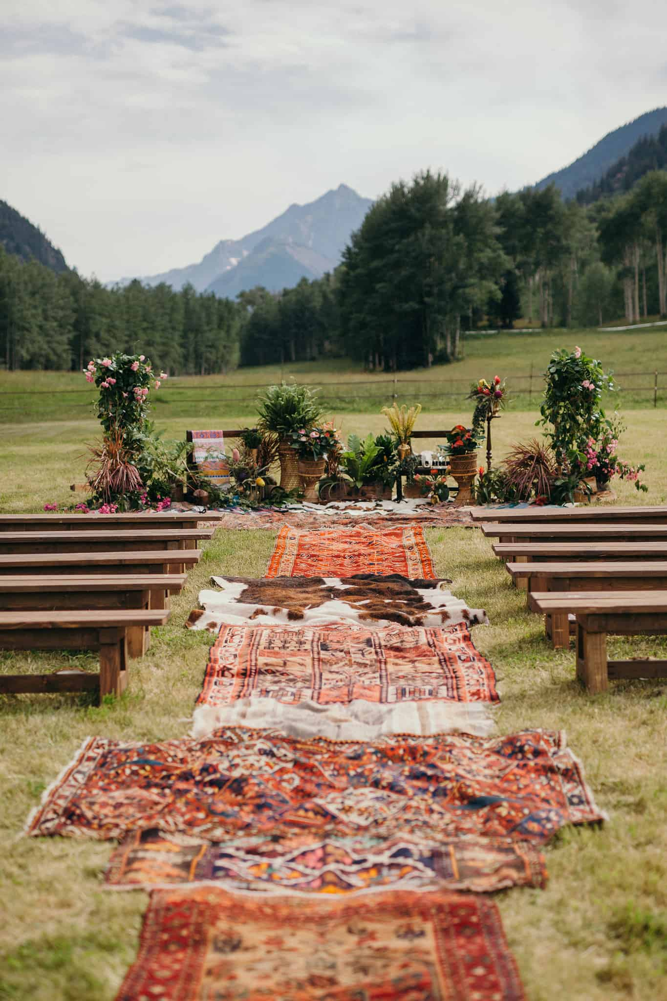 bohemian wedding aisle idea with vintage rugs