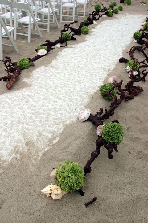beach wedding aisle with driftwood, seashells