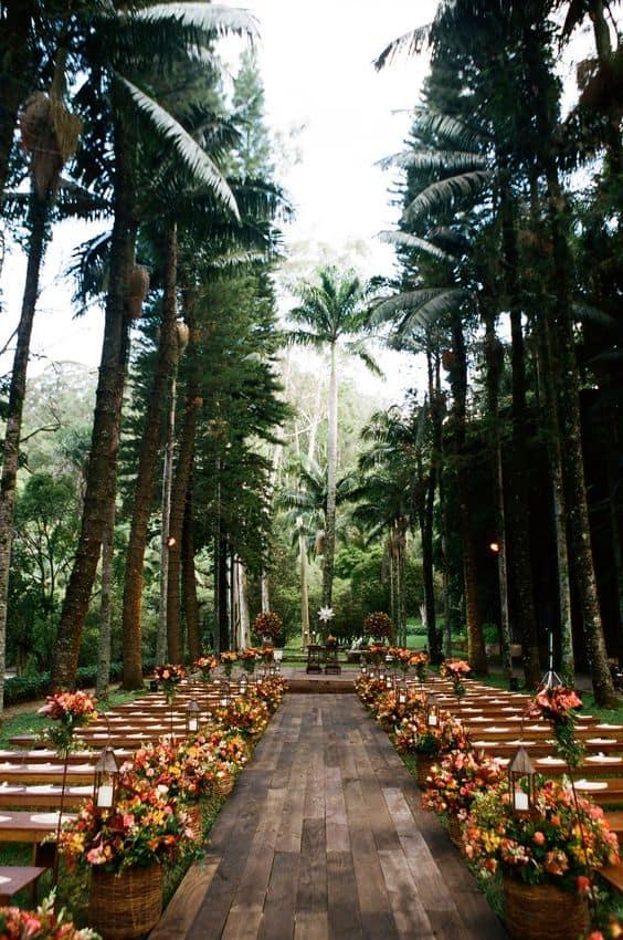wedding aisle decor idea with vibrant flowers
