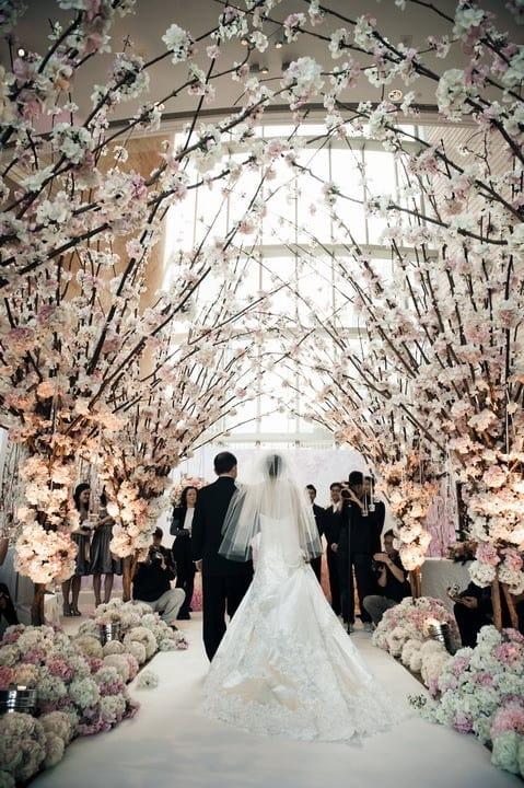White & lush floral wedding aisle