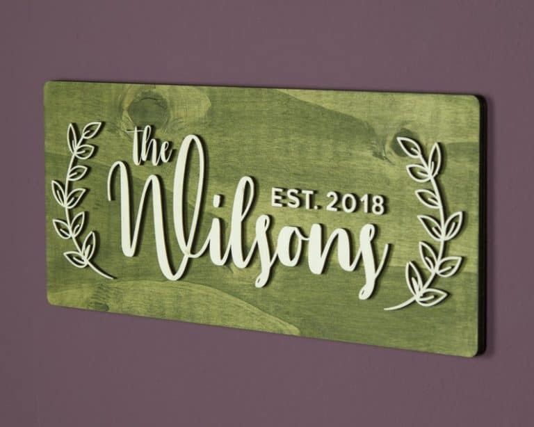 housewarming gift ideas for guys: wooden family name sign