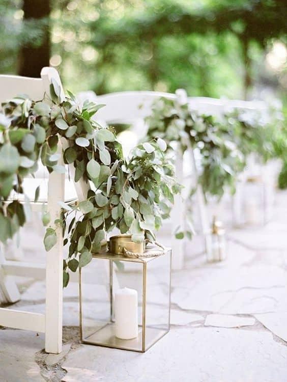 wedding pew decoration idea: modern candle lantern and foliage