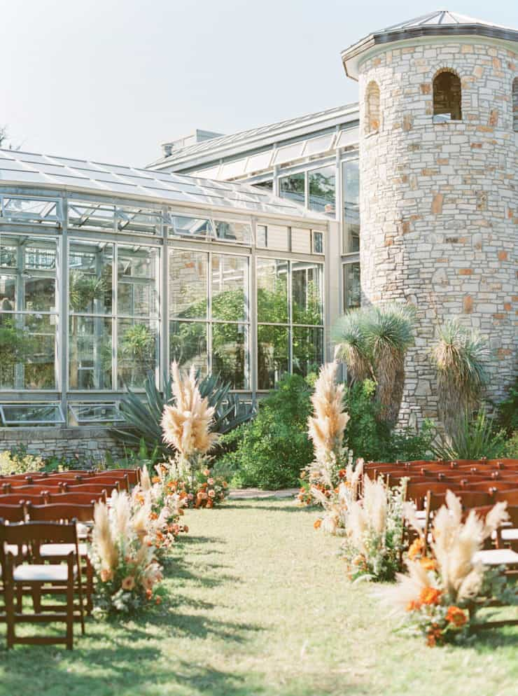 wedding aisle with flowers and pampas grass