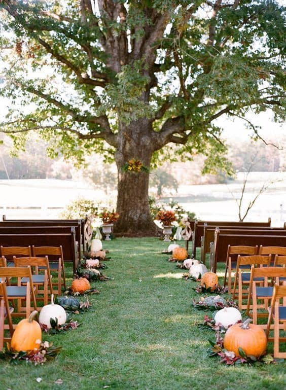 fall wedding aisle decorations with pumpkins and foliage