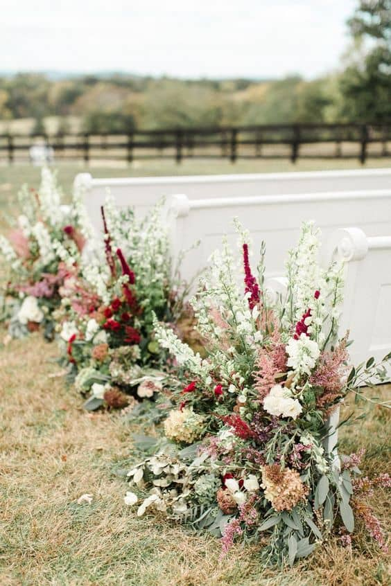 wedding aisle ideas with rustic flowers as aisle markers