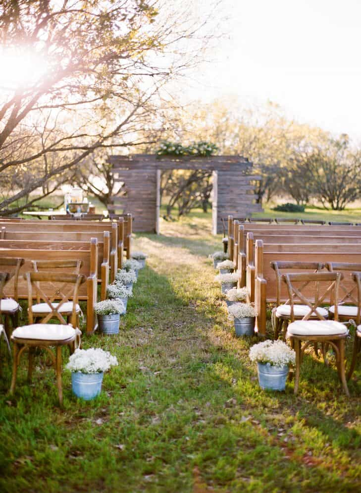 potted flowers for a rustic barn wedding aisle decor