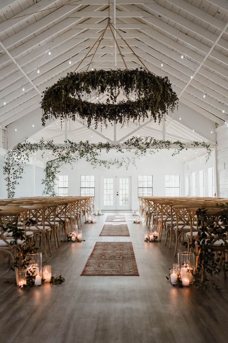 vintage indoor wedding aisle with rugs