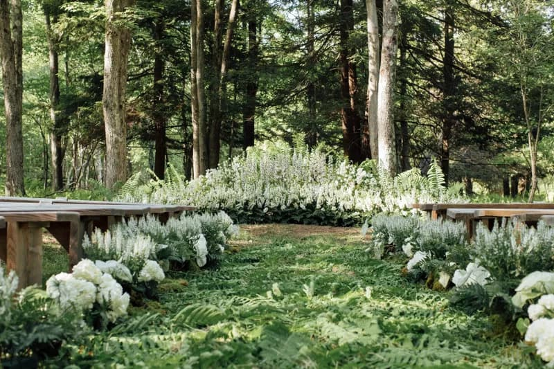 green & earthy wedding aisle decor in a forest
