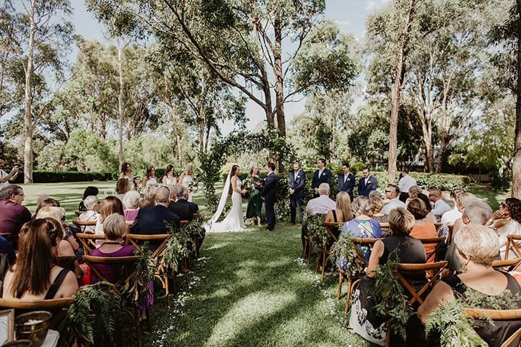 simple wedding ceremony aisle with greenery