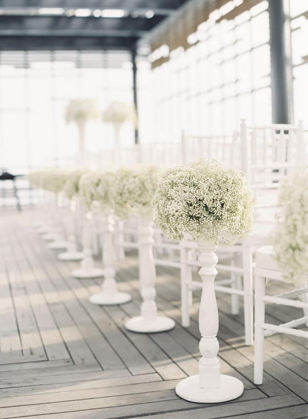 all white decorations for wedding aisle