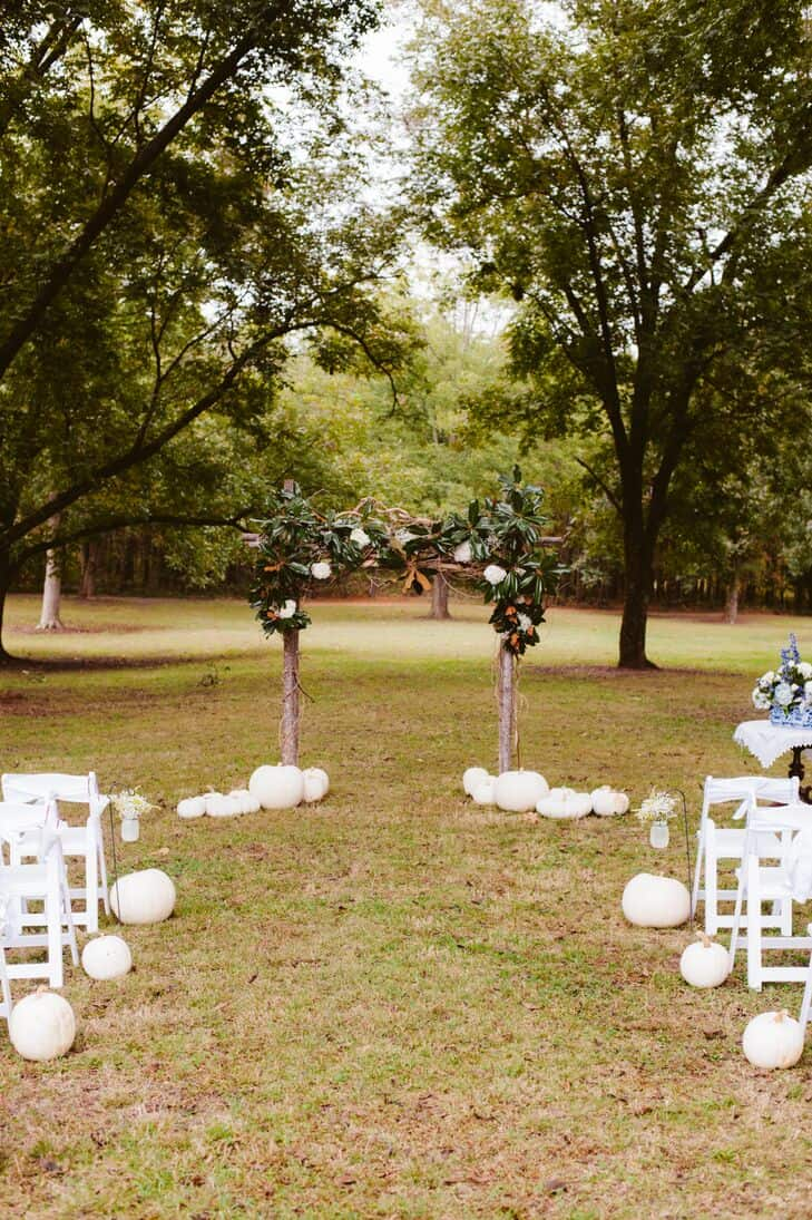 fall wedding ceremony aisle decoration idea with white pumpkins