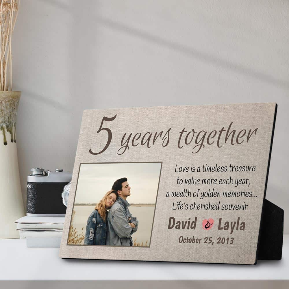 a desktop photo plaque with a 5-year together anniversary quote