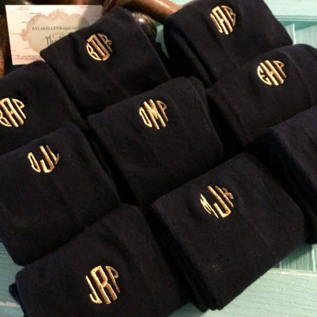 Black Monogrammed Socks with gold text on them - groomsmen gift ideas